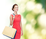 Smiling woman with shopping bags and plastic card Royalty Free Stock Photo