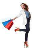 Smiling woman with shopping bags posing on white background Royalty Free Stock Image