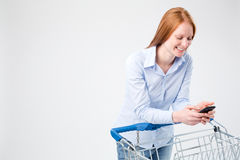 Smiling Woman with a Shopping Cart Stock Images