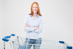 Smiling Woman with a Shopping Cart Royalty Free Stock Image
