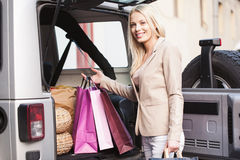 Smiling Woman Shopping Stock Image