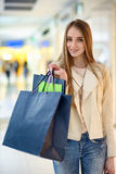 Smiling Woman at the shopping mall with shopping bags Stock Photography