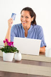 Smiling woman shopping online home credit card Stock Photo