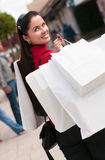 Smiling woman shopping with white bags Stock Images