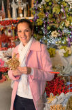 Smiling woman shopping Xmas decorations in shop Royalty Free Stock Image
