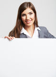 Smiling woman show on big blank board . Stock Photography