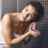 Smiling Woman after Shower Holding her Wet Hair Stock Photography