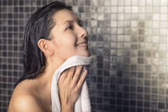 Smiling woman in a shower Stock Images