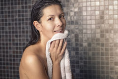 Smiling woman in a shower Stock Photo