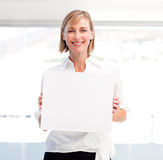 Smiling woman showing a big business card Stock Photo