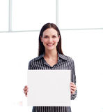 Smiling woman showing a big business card Royalty Free Stock Photography
