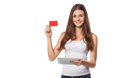 Smiling Woman Showing Blank Credit Card Hold Tablet Pc In Hand, In White T-shirt, Isolated Over Gray Background
