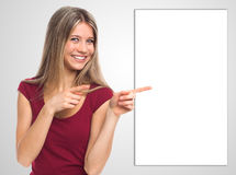 Free Smiling Woman Showing Blank Placard Royalty Free Stock Image - 35377226