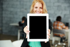 Smiling woman showing blank tablet computer screen Stock Photography