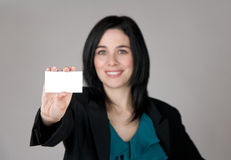 Smiling woman showing a business card Royalty Free Stock Photography