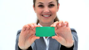 Smiling woman showing a business card Stock Photo