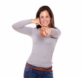 Smiling woman showing call me gesture with hand Royalty Free Stock Images