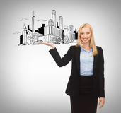 Smiling woman showing city sketch on her hand Royalty Free Stock Photo