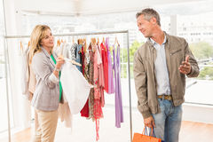 Smiling woman showing clothes to her man Royalty Free Stock Photos