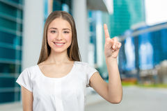 Smiling woman showing copy space. Beautiful happy smiling woman showing copy space Royalty Free Stock Photo