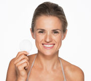 Smiling woman showing cotton pad Stock Photography