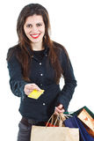 Smiling woman showing credit card Stock Photos