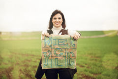 Smiling woman showing eco friendly bag with Recycle text printed. Stock Photography