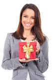 Smiling woman showing a Gift Stock Photos