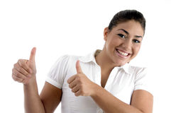 Smiling woman showing good luck gesture Stock Images