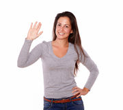 Smiling woman showing greeting gesture with hand Royalty Free Stock Photography