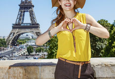 Smiling woman showing heart shaped hands in Paris, France Royalty Free Stock Image