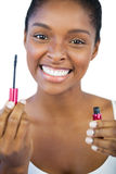 Smiling woman showing her mascara Royalty Free Stock Image