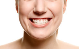 Smiling woman showing her teeth stock photos