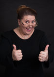 Smiling woman showing hid thumbs up Royalty Free Stock Images