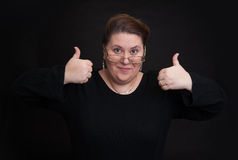 Smiling woman showing hid thumbs up Royalty Free Stock Image
