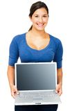 Smiling woman showing laptop. Smiling woman showing a laptop isolated over white Royalty Free Stock Images