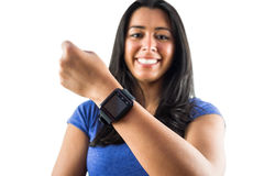 Smiling woman showing off her smartwatch Stock Image