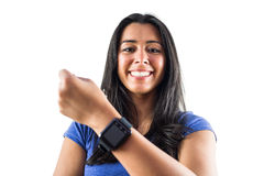Smiling woman showing off her smartwatch Royalty Free Stock Images
