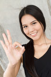 Smiling woman showing ok hand sign Stock Images