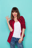 Smiling Woman Showing OK Hand Sign Stock Photos