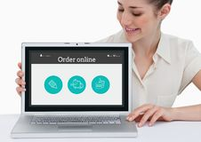 Smiling woman showing online application on laptop screen Royalty Free Stock Photos