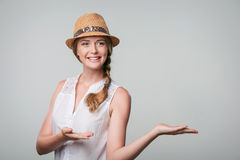 Smiling woman showing open hand palm with copy space for product or text Stock Photo