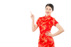 Smiling woman showing pointing gesture Royalty Free Stock Image