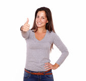 Smiling woman showing positive sign with fingers Royalty Free Stock Images