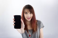 Smiling Woman Showing the Screen of her Phone Stock Photos