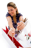 Smiling woman showing shopping bags Stock Photos