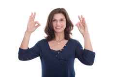 Smiling woman showing sign excellent with fingers. Stock Photos