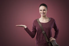 Smiling woman showing something with her hand Royalty Free Stock Photo