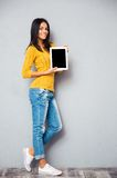 Smiling woman showing tablet computer screen Royalty Free Stock Photo