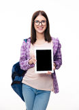 Smiling woman showing tablet computer screen Stock Photography